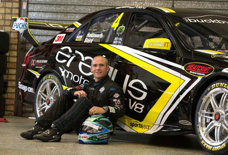Lee Holdsworth in front of his 2014 V8 Supercar which featured the Sportsyear logo.