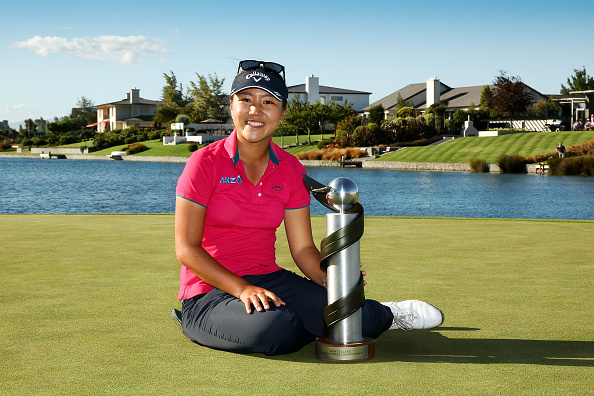 Ko poses with her home Country's NZ Golf Open trophy in March.